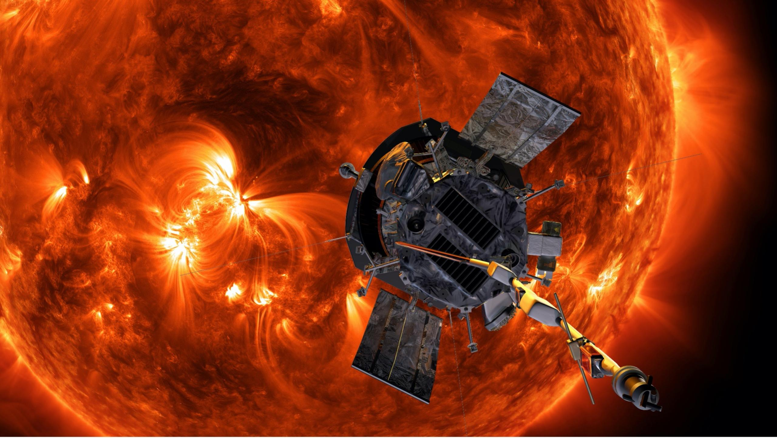Artist concept of spacecraft in front of orange sun.