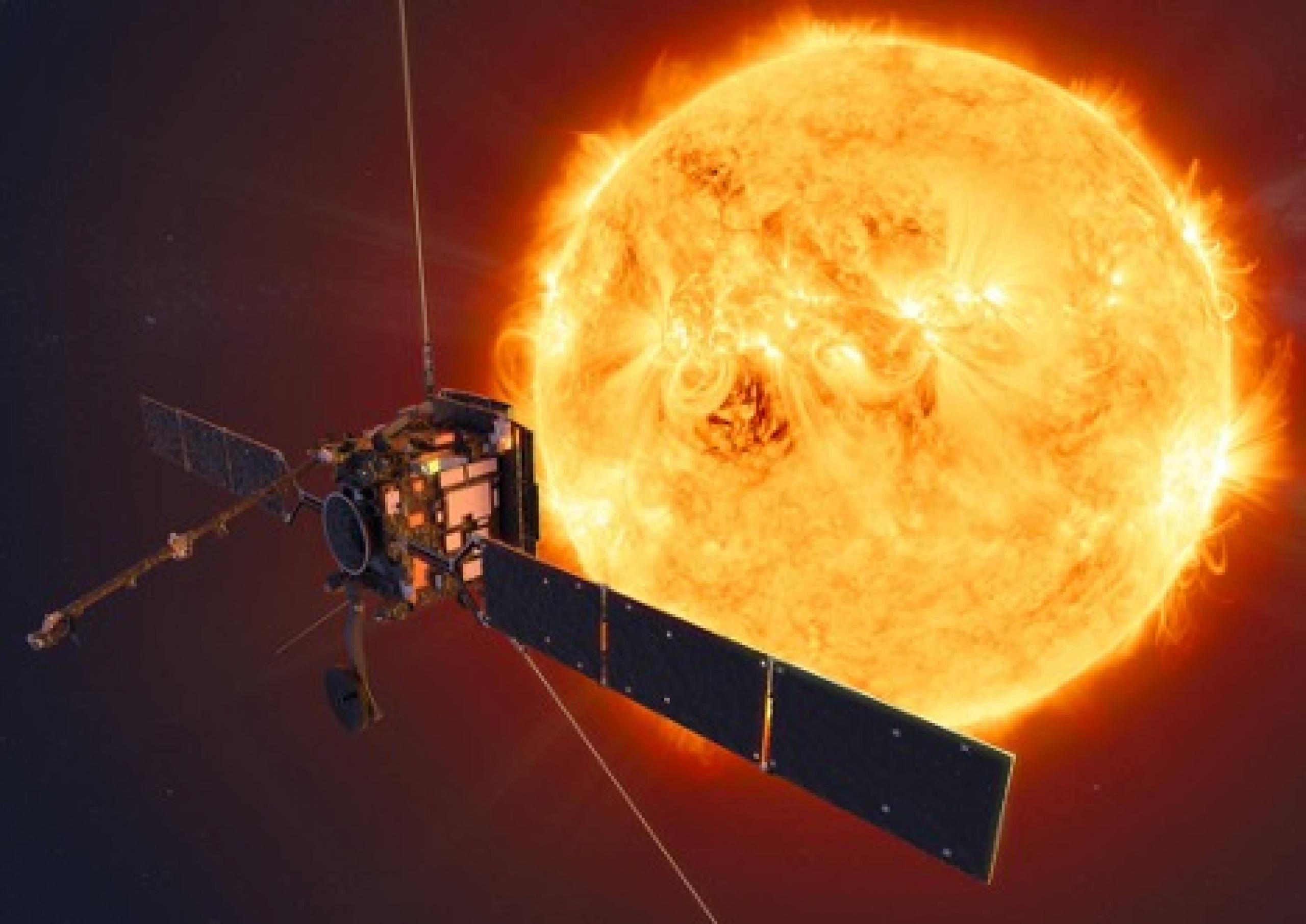 Image of satellite in front of orange sun