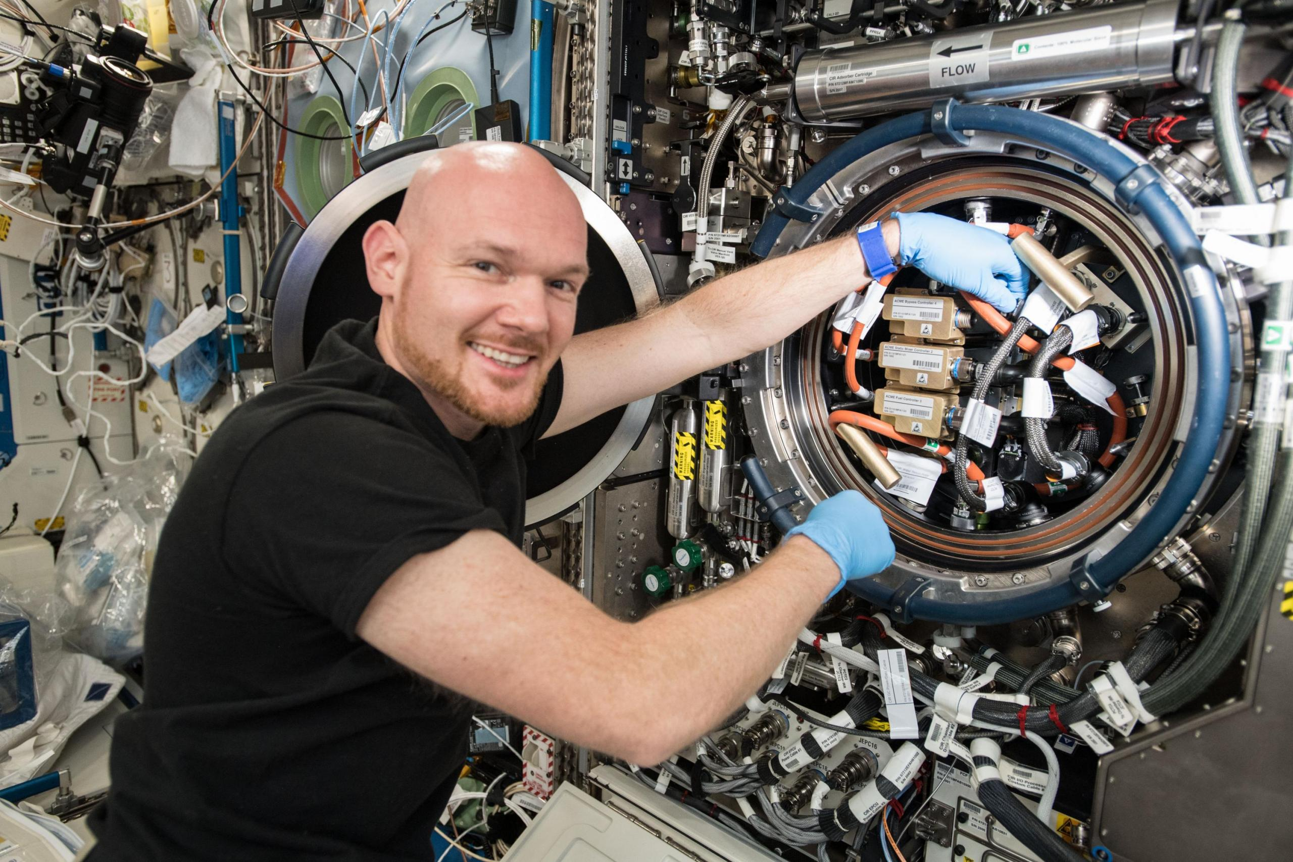 Photo of Astronaut Alexander Gerst replacing a gear on the ISS