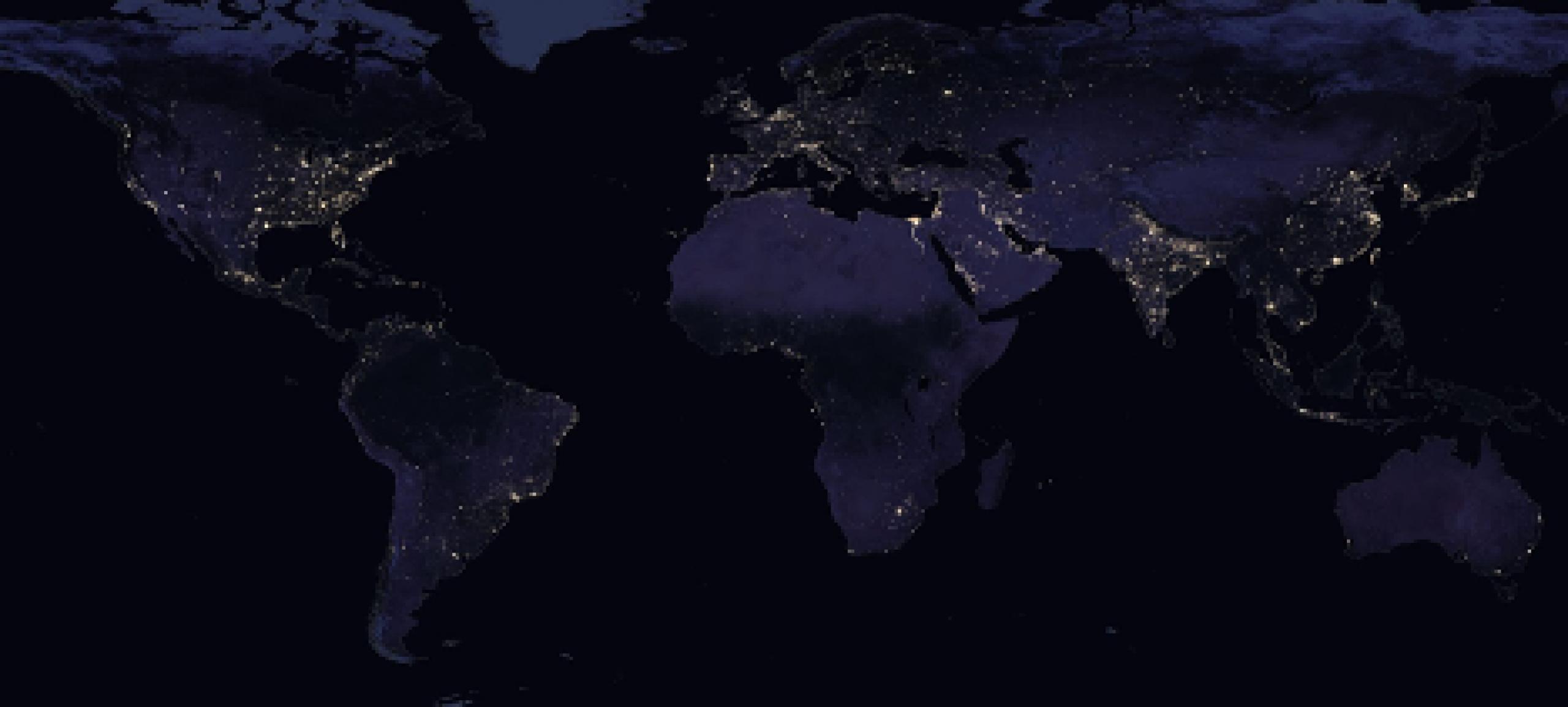 World map at night with lights illuminating