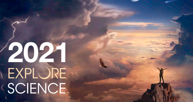 2021 Explore Science calendar cover with a person standing in the distance on a rock formation and clouds in the sky