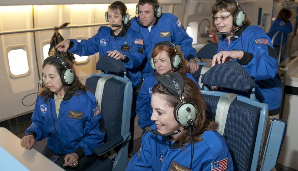 Photograph of team of pilots in cockpit
