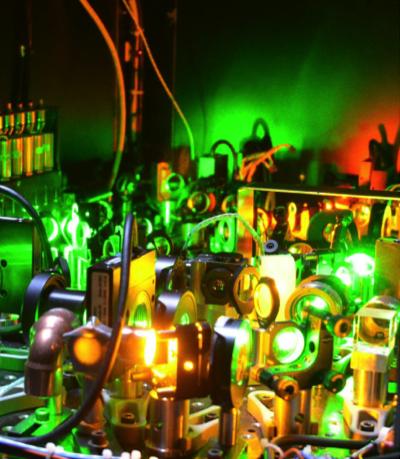 Optical components of the NASA Langley High-Spectral Resolution Lidar (HSRL) illuminated by laser light. Credit: NASA/A. Nehrir.