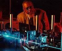 Dr. Donald Frazier monitors a blue laser light