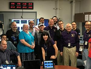 The current and alumni Cassini radio science team pose for a group photo.