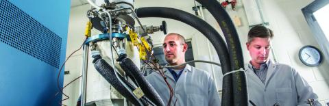 Photo of Salvatore Oriti and Scott Wilson inspect power converter TDC #13 in NASA GRC's Stirling Research Laboratory