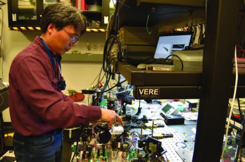 Photo of Dr. Kenji Numata testing the mNPRO modules.