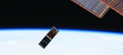 Photo of RainCube and HaloSat CubeSats following ISS deployment