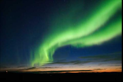 Aurora in sky, green lights