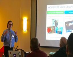A man gives a presentation to teachers