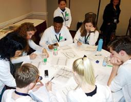 High school students study at a round table
