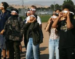 High school students wearing eclipse glasses