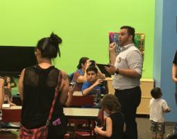 Dr. Edgard Rivera-Valentín speaking to children with VR headsets.