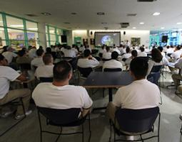Incarcerated men listen to an astrobiology lecture.