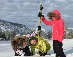 Photo of people taking snow measurements