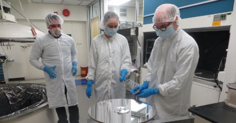 Photo of engineers in GSFC coating lab