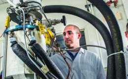 Photo of Salvatore Oriti and Scott Wilson inspect power converter TDC #13 in NASA GRC's Stirling Research Laboratory