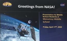 "Picture of a slide titled ""Greetings from NASA!"" with a satellite. It also reads ""Presentation for middle school students at Monomoy Middle School""."