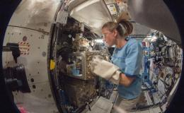 NASA astronaut Karen Nyberg, Expedition 36 flight engineer, as she conducts a session with the Advanced Colloids Experiment (ACE)-1 sample preparation at the Light Microscopy Module in the Fluids Integrated Rack / Fluids Combustion Facility.
