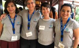 Photo of 4 female team members