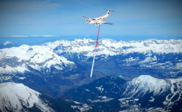 Image of airplane scanning snow fall in landscape