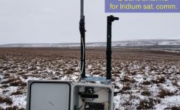 Photo of SoilSCAPE base station in a field in Alaska