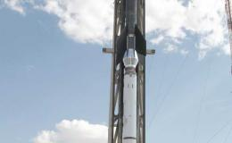 Photo of team standing next to sounding rocket