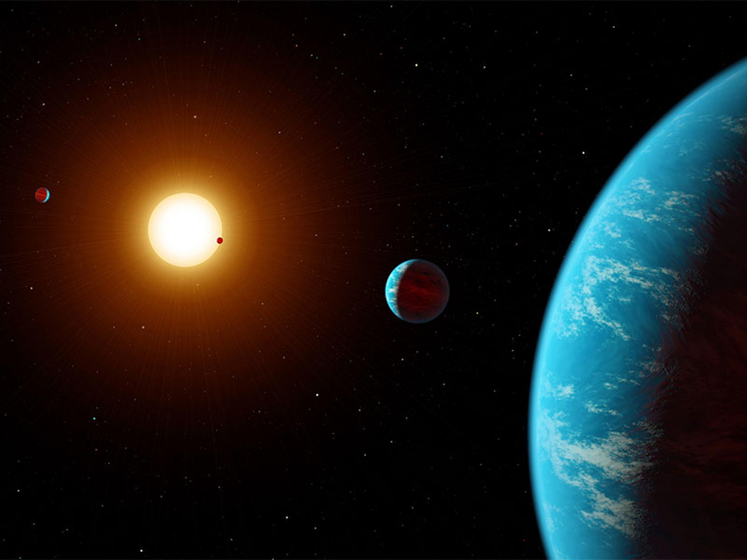 this artist concept shows K2-138, the first multi-planet system discovered by citizen scientists.