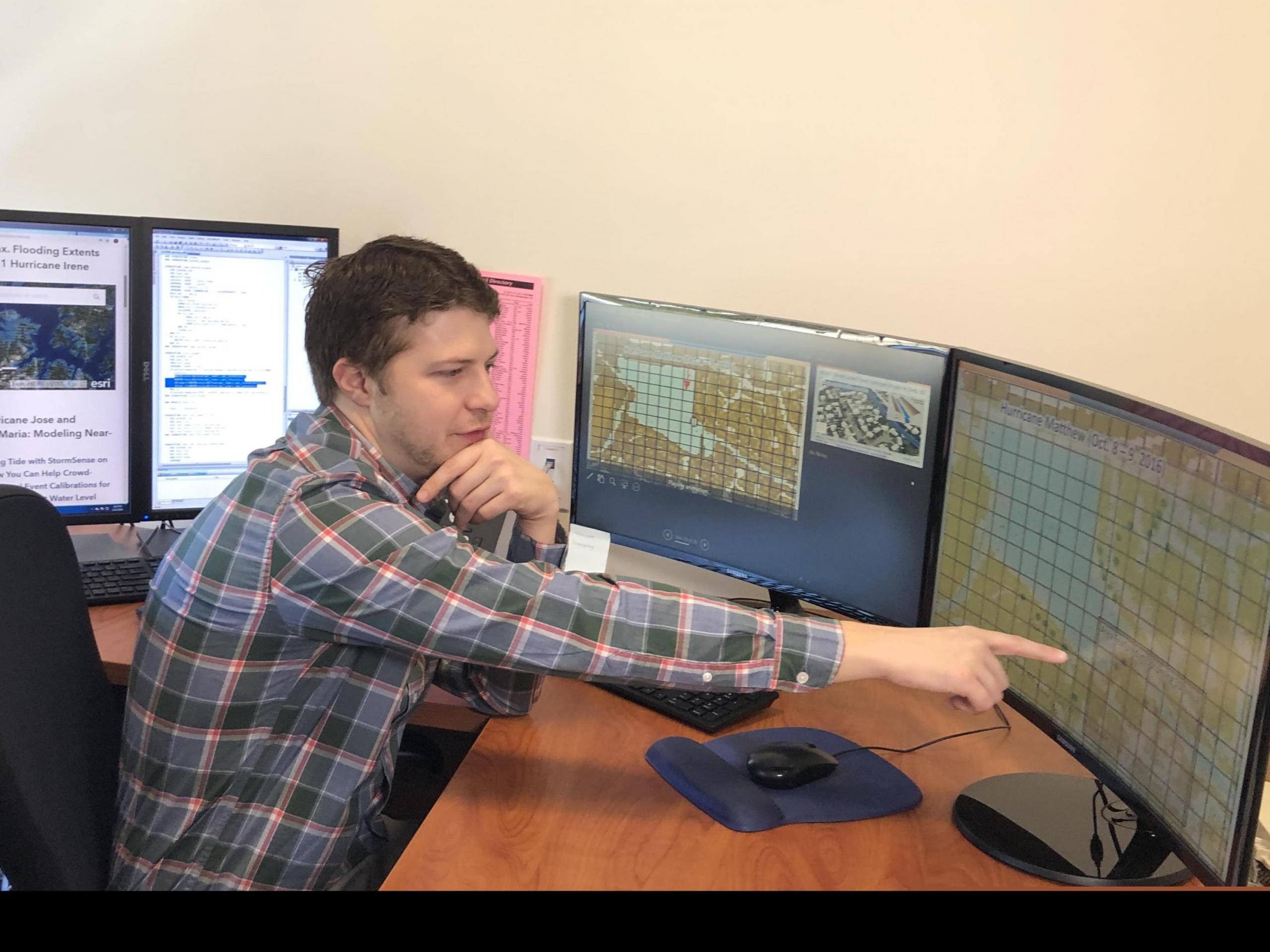 Photo of Derek at computer