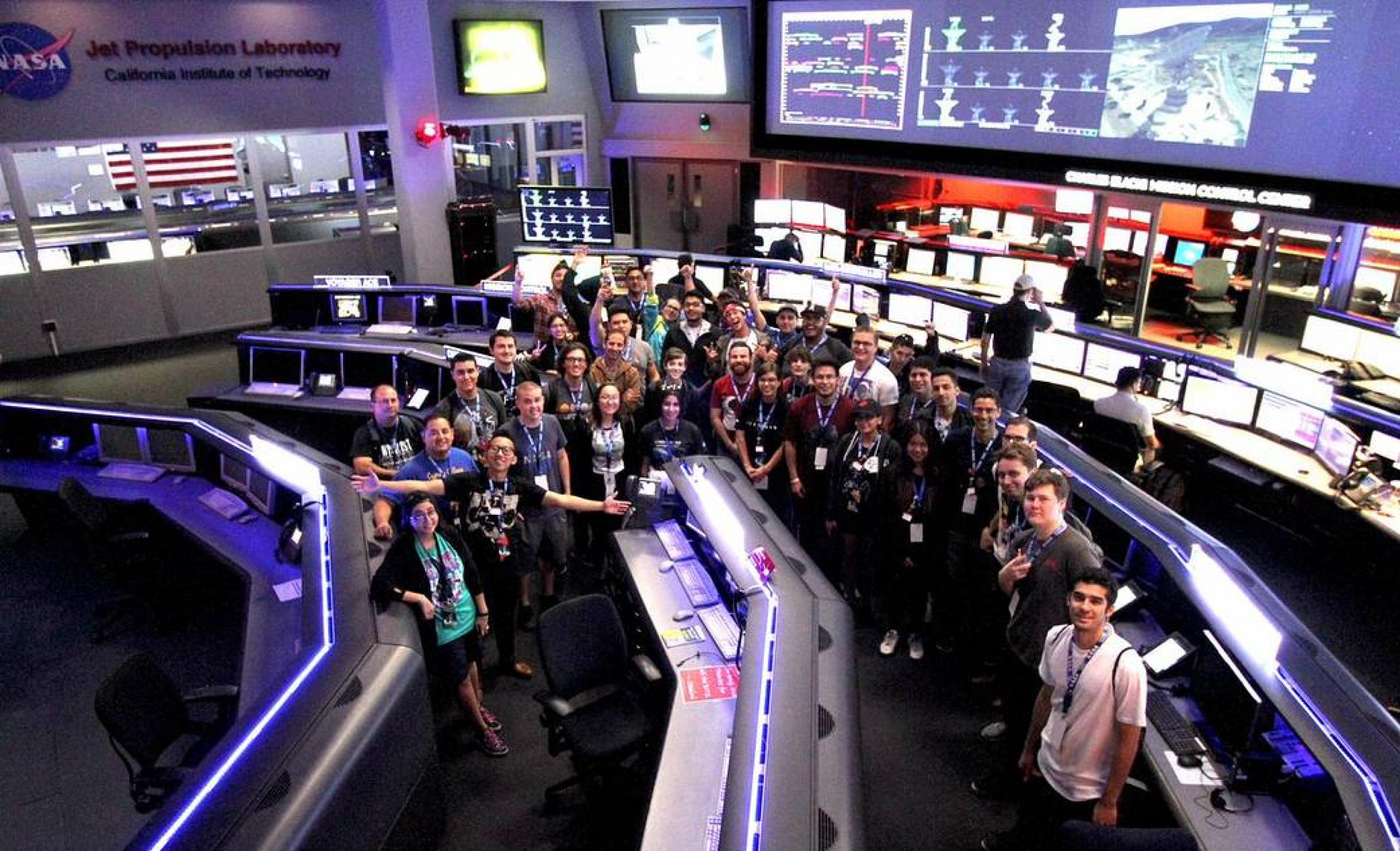 Group of students assembled in a spacious control center.