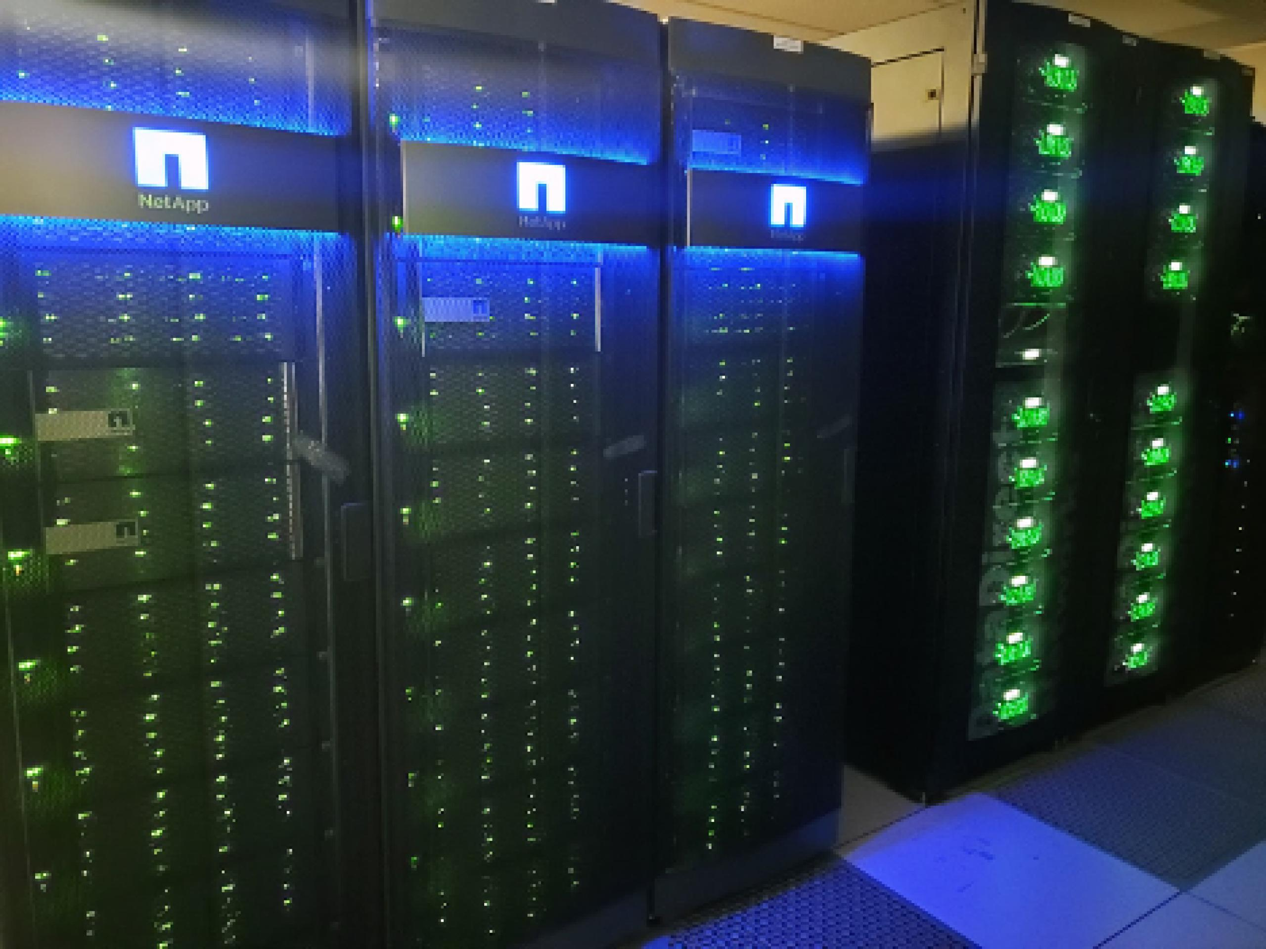 Photo of large computer servers with blue and green lights