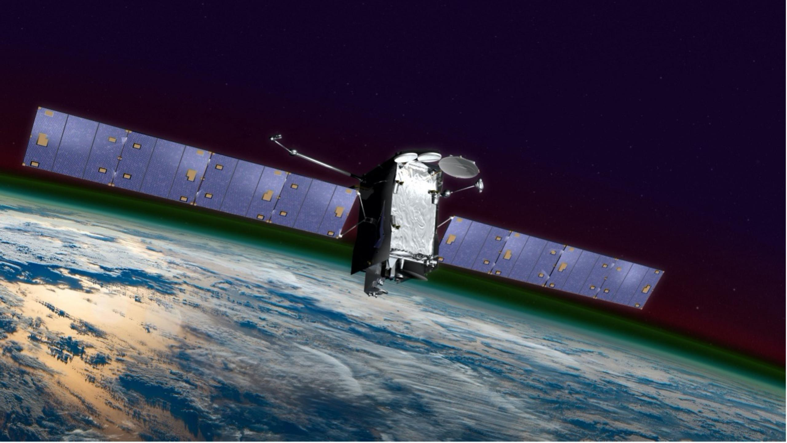 Artist concept of satellite in orbit above the Earth