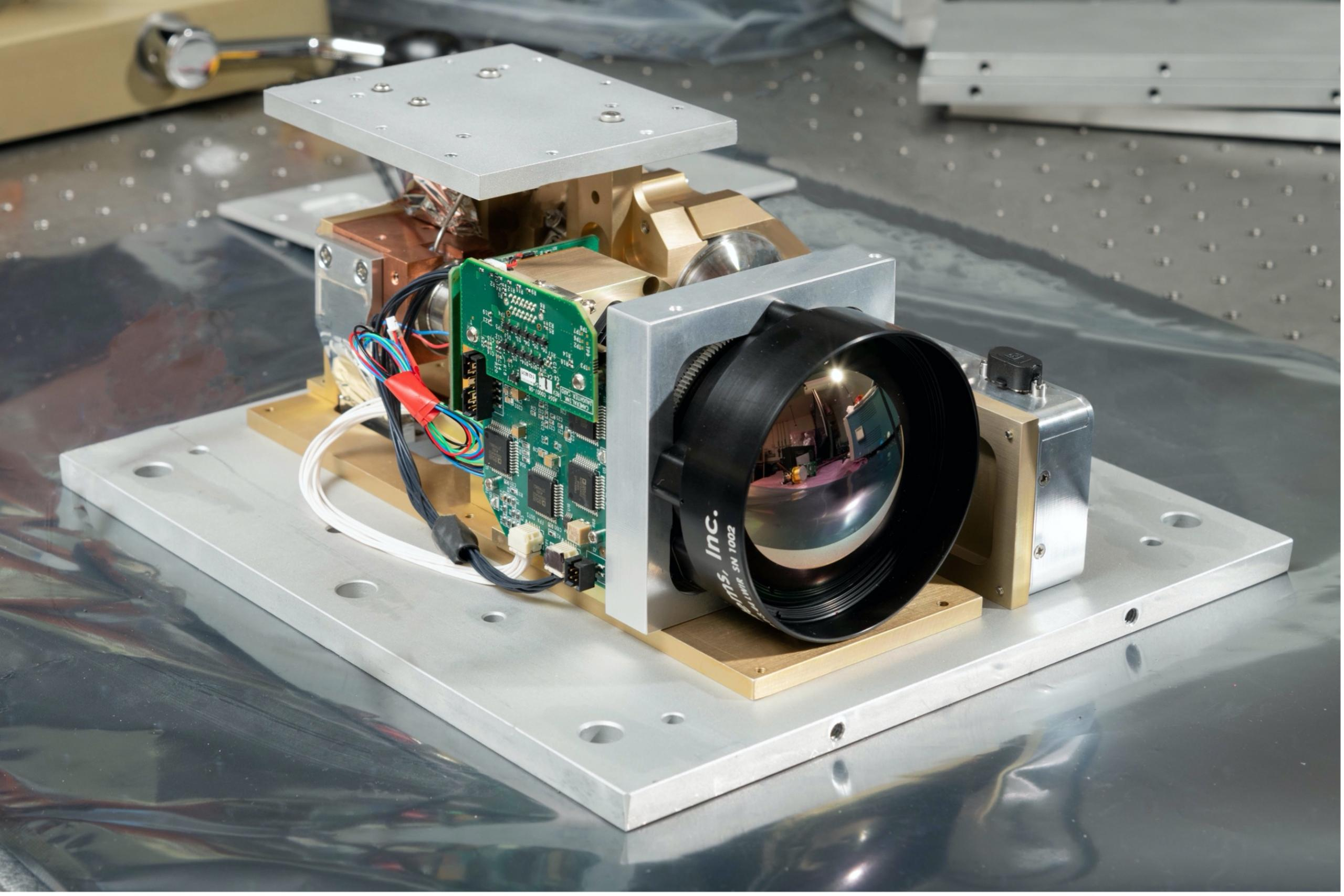 Photo of camera instrument with lens on a table.