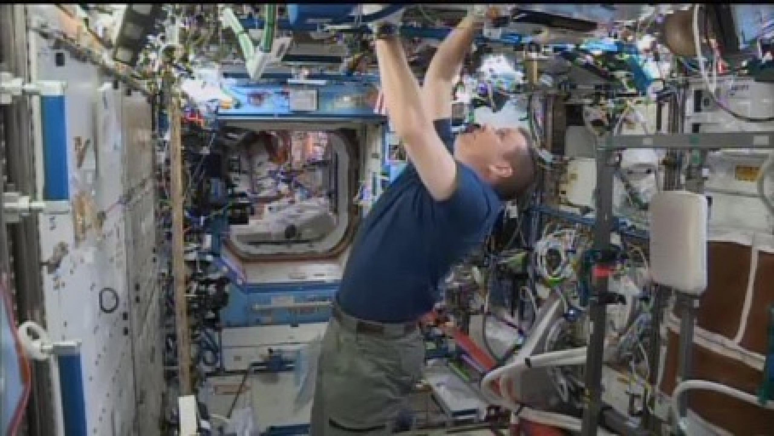 An astronaut working on the space station.