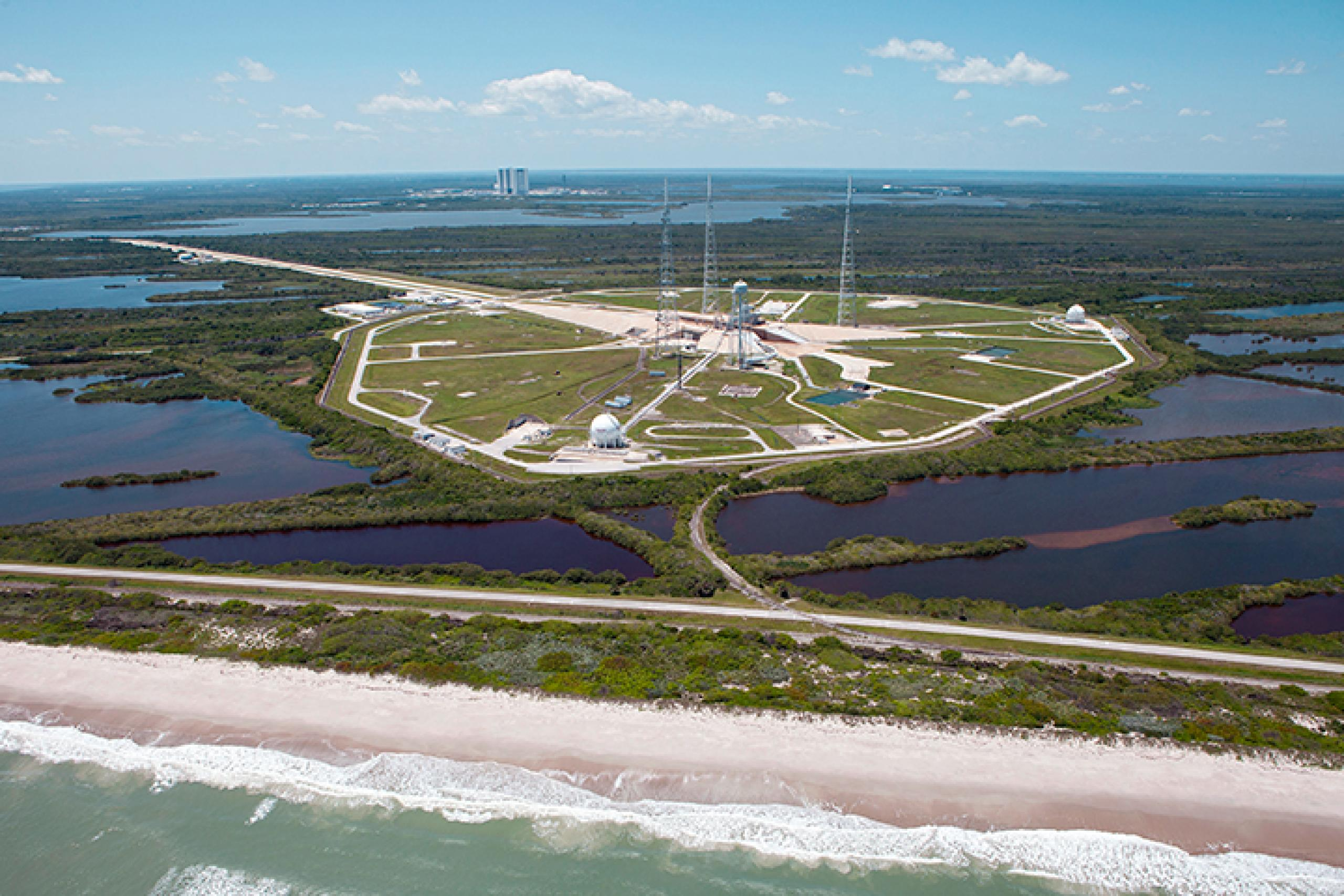 Photo of launch pad surrounded by a body of water