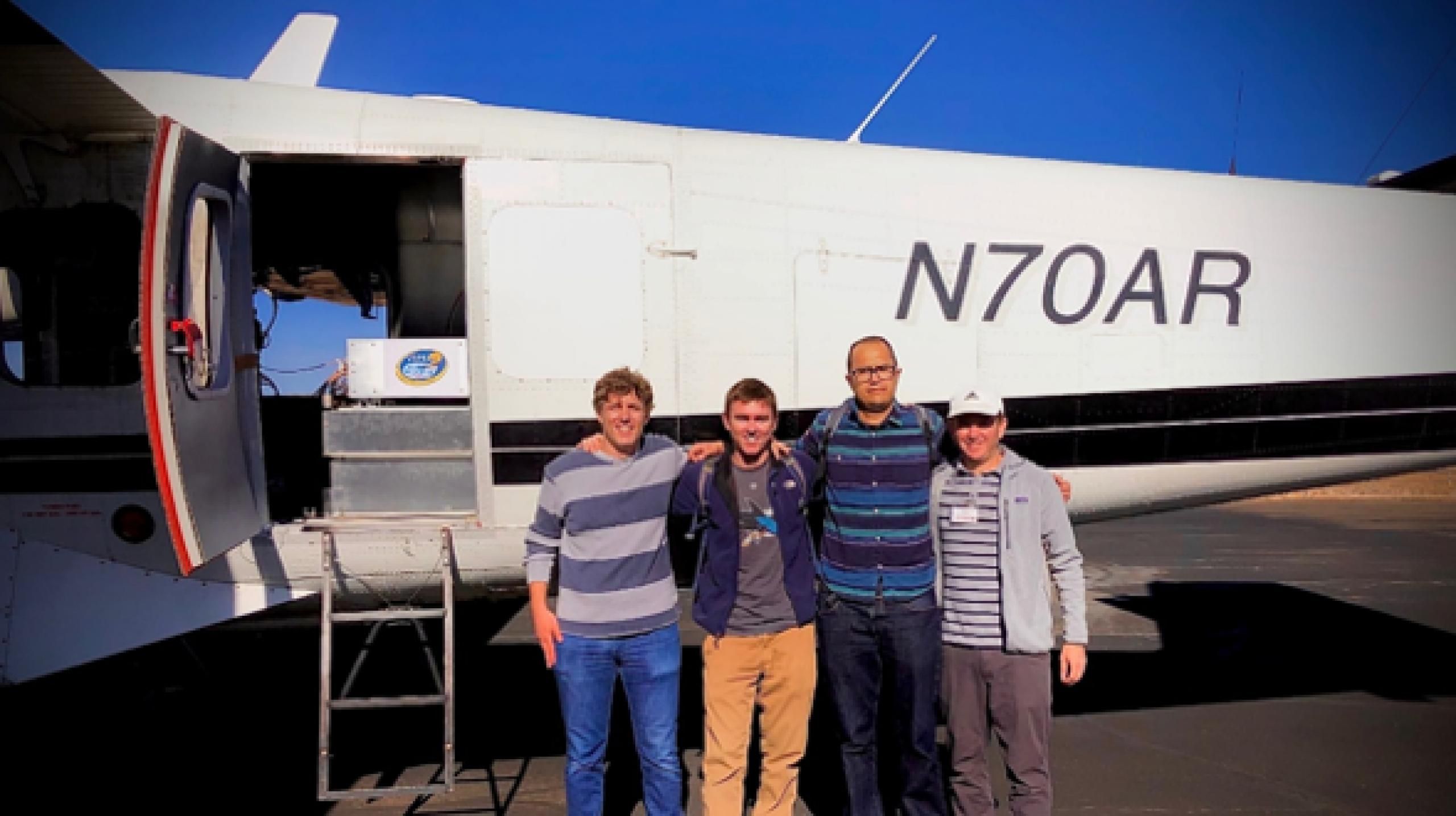 Photo of some members of the WASSR team loading science gear onto an aircraft