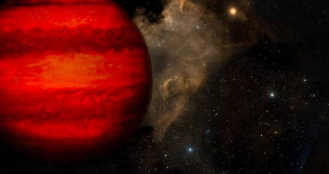 A reddish brown dwarf with bands of coloration hovers in the left foreground.