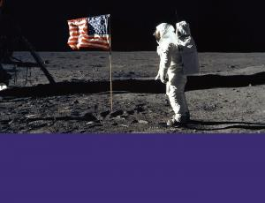 Buzz Aldrin stands with the American flag on the moon during the Apollo 11 mission.