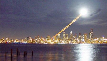 A time-lapse sequence of the moon rising over Seattle. To the camera, the moon appears to be the same size no matter what its location on the sky.