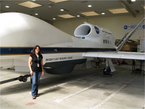 Amber standing in front of the Northrop Grumman RQ-4 Global Hawk unmanned aircraft.