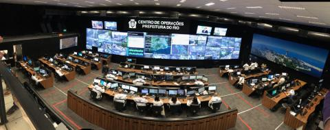 Photo of desks and computer screens in control center