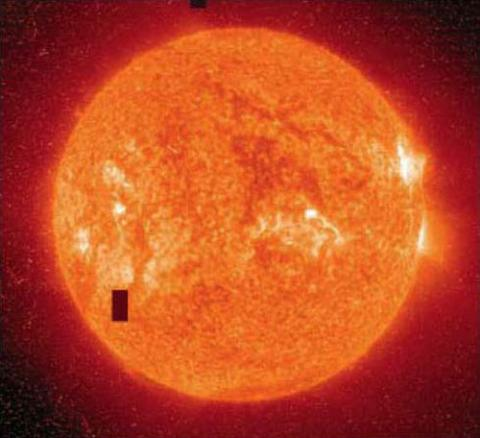 Image of an oragne sun with a solar flare shooting out.