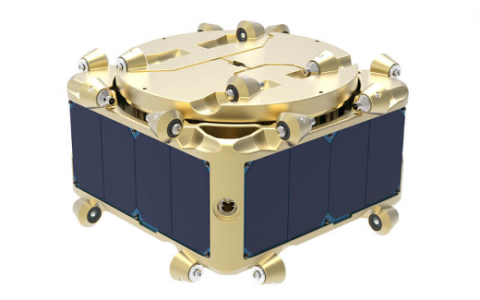 A 3D representation of a modular instrument; a metallic gold object with dark blue panels and wheels
