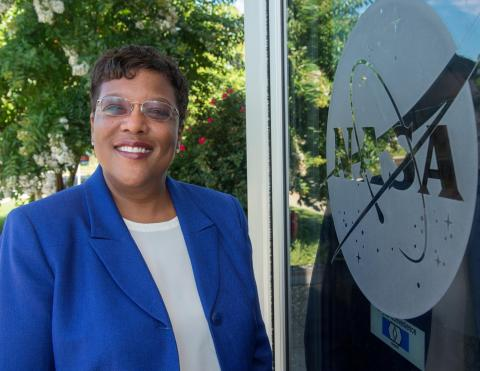 Photo of Dr. Wanda Peters in front of the NASA logo on glass