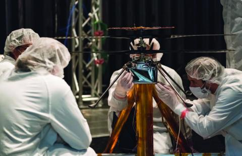 Photo of scientists working on a test with the Mars Helicopter