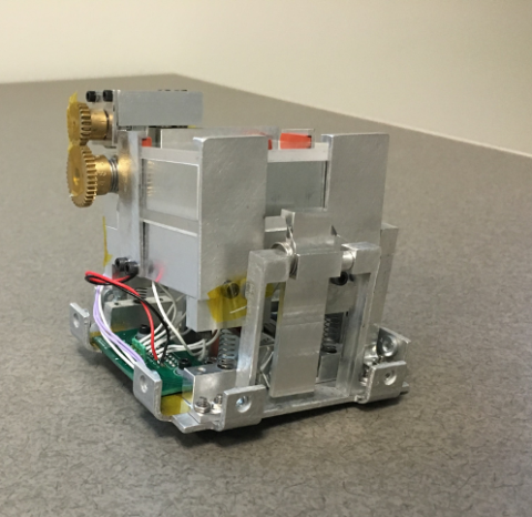 Photo of the Q-Pace test chamber, a small grey metal box with electronics.