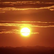 Sun setting in the sky