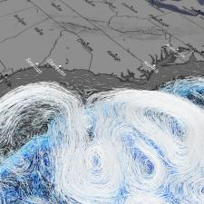 Grey map with blue and white lines indicating weather pattern movement