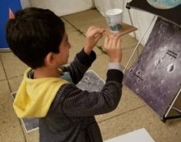A young participant preparing to test out his lunar lander, aiming for the Moon's south pole.