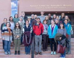 A group of people on the steps of the National Center for Atmospheric Research.